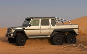 Mercedes-Benz-G63-AMG-6x6-silver-side-view-in-sand-1024x640