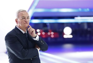 Volkswagen CEO Winterkorn waits for German Chancellor Merkel during opening of Frankfurt Motor Show
