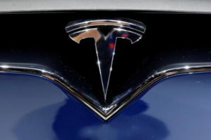 A Tesla logo is seen on media day at the Paris auto show, in Paris, France, September 30, 2016. REUTERS/Benoit Tessier/File Photo
