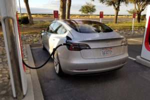 Tesla-Model-3-at-Supercharger-Rear