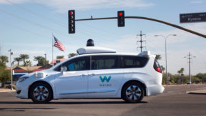 A Waymo self-driving vehicle moves through an intersection in Chandler Arizona, U.S., December 2, 2017.  Photo taken on December 2, 2017.  REUTERS/Natalie Behring