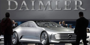 Visitors look at a Mercedes Benz concept car prior to the shareholders meeting of the Daimler AG in Berlin, Germany, Wednesday, April 6, 2016. (AP Photo/Michael Sohn)