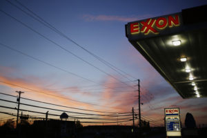 ExxonMobil Corp. signage glows at a gas station in Richmond, Kentucky, U.S. at dawn on Wednesday, April 29, 2015. Photographer : Luke Sharrett / Bloomberg