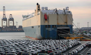 Rows of new automobiles stand on the dockside ahead of export as a roll-on/roll-off (RORO) cargo ship Morning Lily, operated by Eukor Car Carriers Inc., sits docked at the BLG Logistics Group AG terminal at the Port of Bremerhaven in Bremerhaven, Germany. Photographer: Krisztian Bocsi/Bloomberg