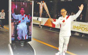 Президентът на Toyota - Акио Тойода, вдясно, се появи за летните олимпийски игри…